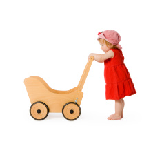 stock-photo-11215617-girl-and-toy-wagon-baby-carriage-toddler-child-pushing